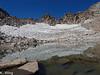 Tarn and snowfield before Lamarck Col