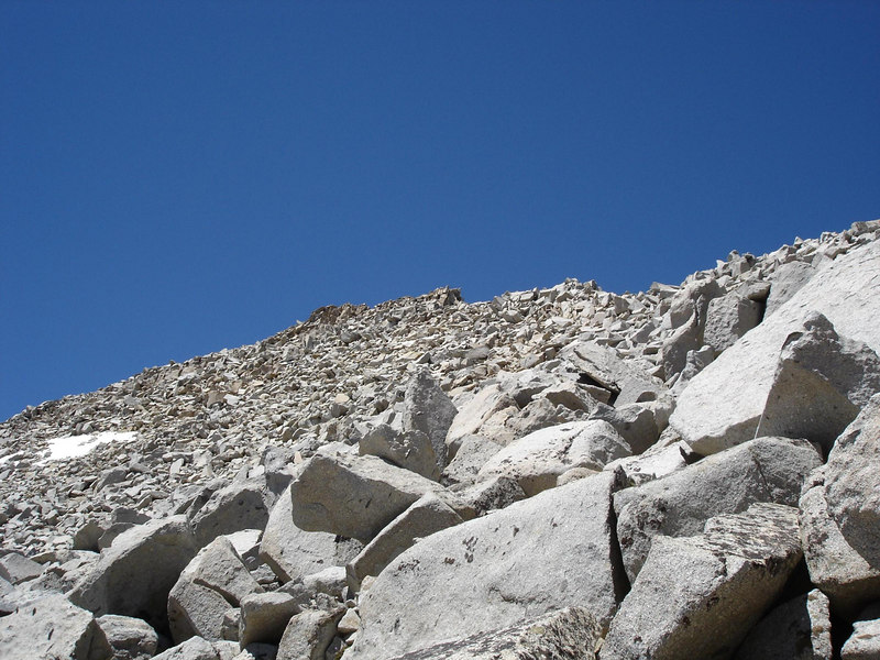 In the sand and rocks - The summit of Goode ahead.