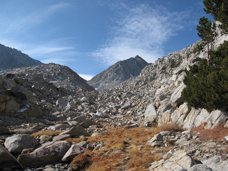 Mount Johnson peaks out above the boulders