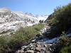 Water was flowing strong along the JMT - I'm going to camp up in a gentle area ahead near the trees.