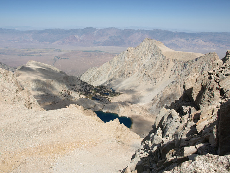 Lone Pine Peak to the right of center and Candlelight Peaklet on the left side of the picture.  The Inyos in the distance on the other side of Owens Valley.  Meysan Lake, Camp Lake, Grass Lake and Peanut Lake below.