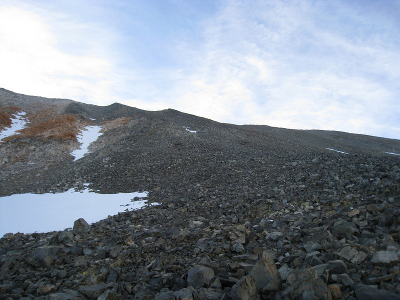Up the pile of rubble - those two bumps on the left are false summits.  Mount Mary Austin is to the right in the photo.