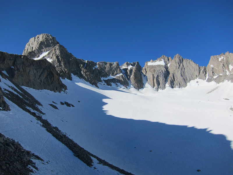 """Mount Sill on the left and North Palisade right of Center.  I followed the boot tracks across up high on the snow above Palisade Glacier toward the chute the goes to Glacier Notch.  The entrance to the chute to Glacier Notch, Apex Peak, and Mount Sill with part of the North Couloir's L-Shaped snowfield showing are on the left side of the photo.  The """"U"""" Notch and """"V"""" Notch are near the center in this photo for those heading to North Palisade or over in that area."""
