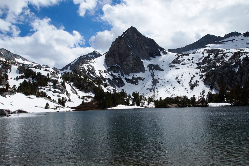 A Treasure Lake. Mount Johnson Peaking out in the back at the left of the peak without a name in the center -front.