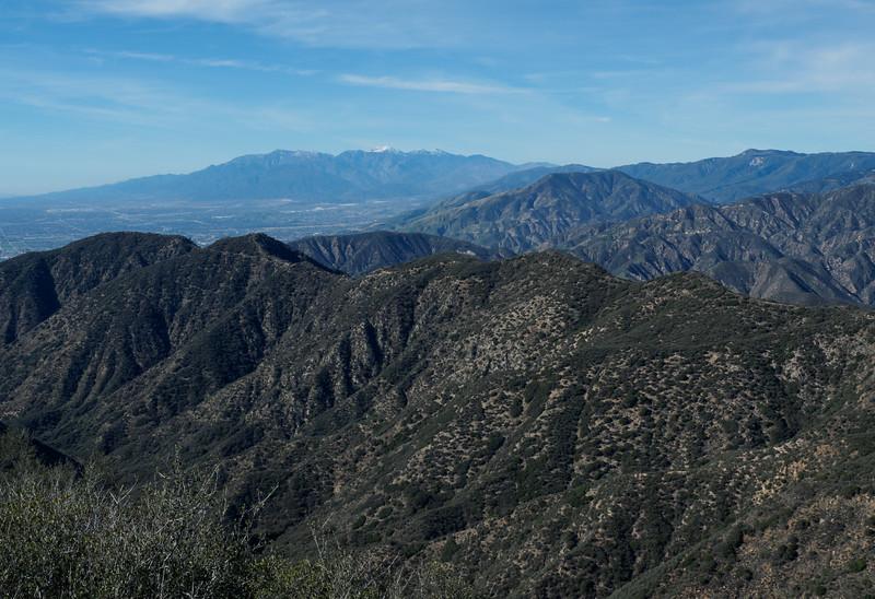 View of Cram Peak, Harrison Peak, and McKinley Peak with Mount San Antonio (Baldy) in the distance.