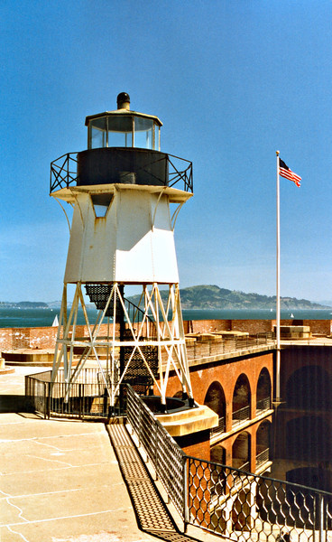 The Army constructed Fort Winfield Scott on the land the lighthouse formerly occupied. In 1855 the second Fort Point Light tower was constructed on a narrow ledge between the fort and the Bay. The light was a wooden 4 sided truncated tower which stood 36 feet high. A Fifth Order Fresnel lens was installed in the lantern which exhibited a white fixed light.