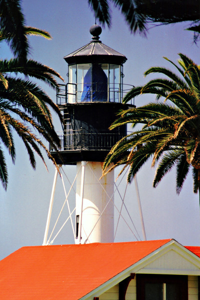 The lighthouse was automated in 1973.  In 1997 the lens stopped rotating due to rust & warping.  Since repairs would have been costly, a replacement light was installed on the balcony.  The Fresnel lens was covered with a blue canvas bag, seen in these pictures.  In 2002 the lens was removed from the tower, restored and placed on display near the Old Point Loma tower in 2004.  The station today provides housing for Coast Guard officers.