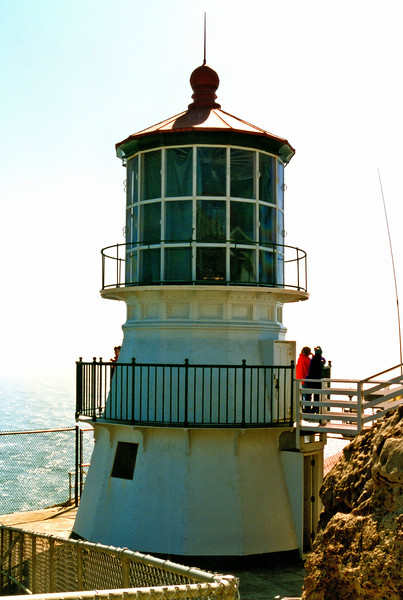 In 1975 the station was automated and a small automated light was installed alongside the tower.  The lighthouse and lens were left intact to serve as a backup.
