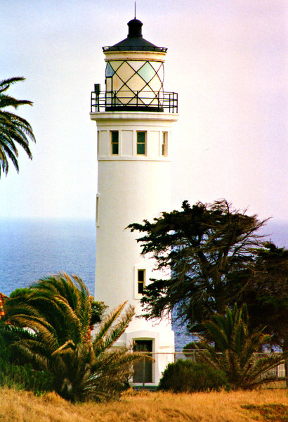 Construction proceeded on three Keeper's dwellings, the lighthouse tower, a fog signal building and various outbuildings.  They were built in Spanish Revival style with a stucco finish and red tiles on the roofs.  The fog signal was completed and activated on June 20, 1925.