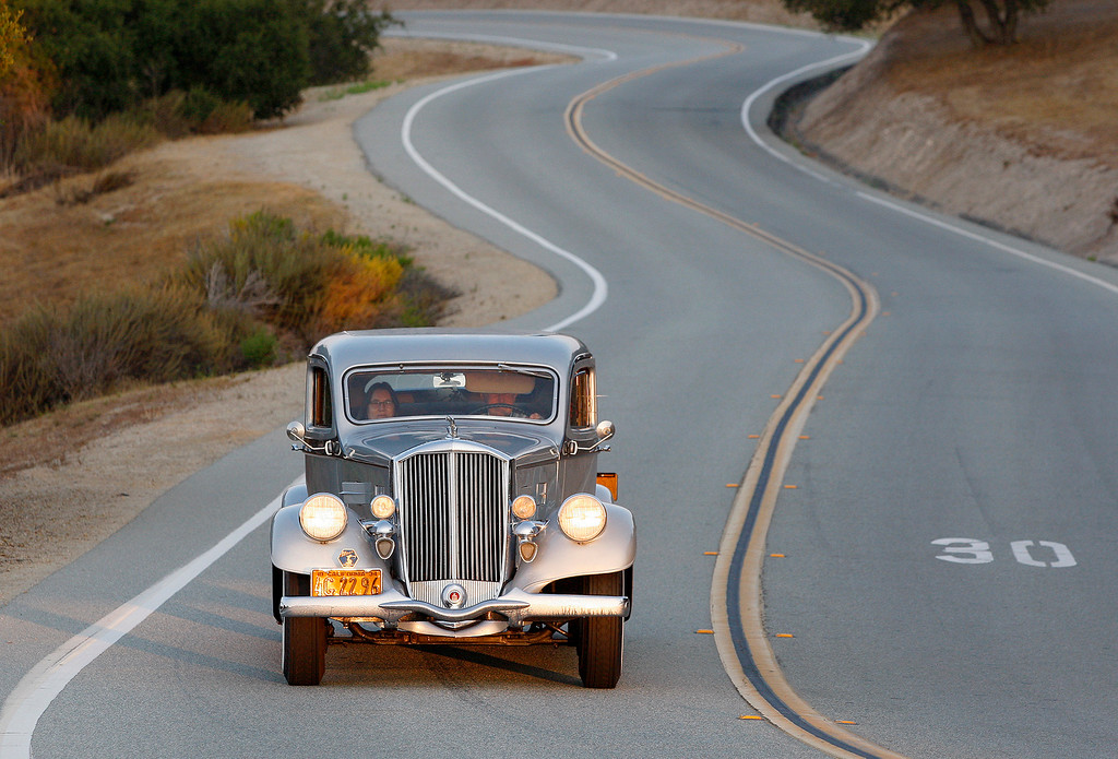 . George Teebay drives his 1934 Pierce Arrow to Laguna Seca on Thursday, August 9, 2018 to participate in the California\'s Dream Drive celebrating the re-opening of Highway 1.  Dozens of classic cars and modern day vehicles drove from Monterey County to San Luis Obispo County.  (Vern Fisher - Monterey Herald)