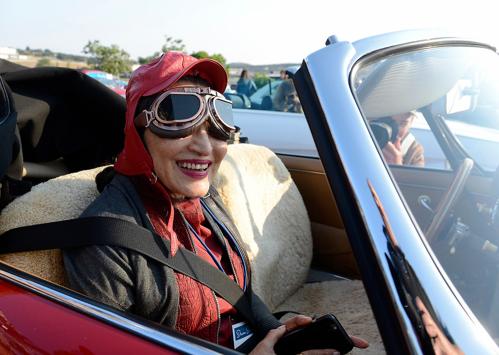 . Sathya Saran, reporter frm the Japan Times at Laguna Seca on Thursday, August 9, 2018 to participate in the California\'s Dream Drive celebrating the re-opening of Highway 1.  Dozens of classic cars and modern day vehicles drove from Monterey County to San Luis Obispo County.  (Vern Fisher - Monterey Herald)