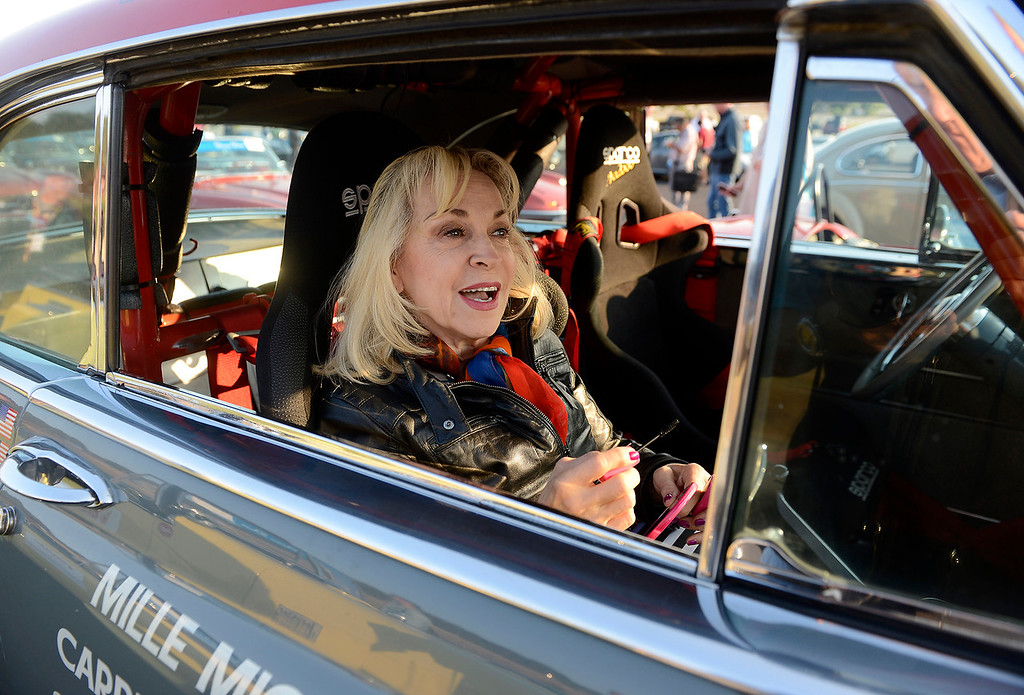 . Susan Buchanan from Menlo Park in her 1954 Chrysler New Yorker at Laguna Seca on Thursday, August 9, 2018 to participate in the California\'s Dream Drive celebrating the re-opening of Highway 1.  Dozens of classic cars and modern day vehicles drove from Monterey County to San Luis Obispo County.  (Vern Fisher - Monterey Herald)