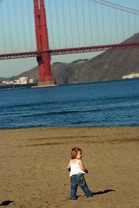 Random Kid playing on the beach