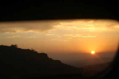Sunset from the back window of the car