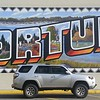Mural on the side of Ray's Grocery,  Fortuna.  Depicts the Eel River and various trades and entertainment activities in the coastal Eel River valley.