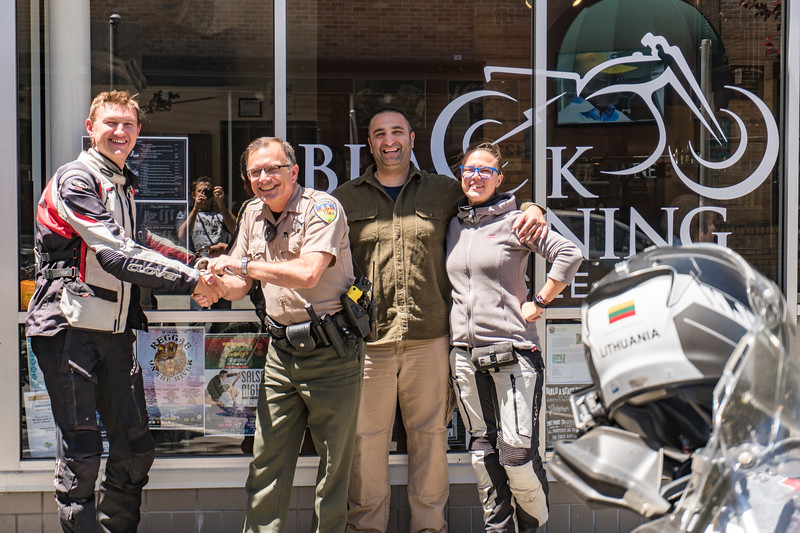 """We hosted Linis and Asta, from Lithuania, who are riding around the world over 18 months on motorcycles.  They are about 260 days into their journey now.  They spent a night with us and then we rode together a bit the next day. <br />  <br /> <br /> Follow their adventure at  <a href=""""http://www.2wheeledadventures.com"""">http://www.2wheeledadventures.com</a><br /> <br /> Linis, HCSO Deputy Greg Bickel (who is a motorcycle rider), me, and Asta at Black Lightning Motorcycle Cafe in Eureka<br /> <br /> Pic by Jeff, owner of BLMC, who is visible in the reflection"""