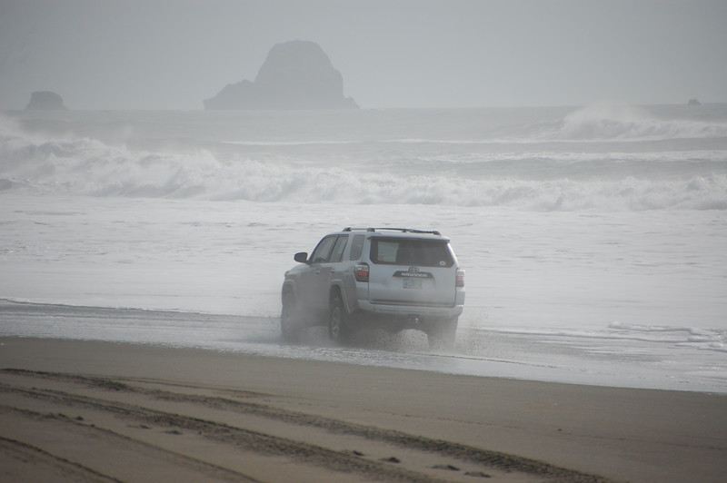 If I drive fast enough I think I can make it to the rocks.  Pacific Ocean at Centerville Beach. (Meredith)
