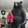 Big bear takes Meredith on his lap at Trees of Mystery