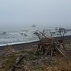 This driftwood fort is almost obscured by fog, ocean-side near Petrolia.