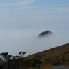 Cape Mendocino (western most point in the continental US) poking through the fog.  Mattole Road in foreground.