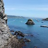 Near Trinidad, fishing boats and rock outcroppings share the bay.  (Meredith)