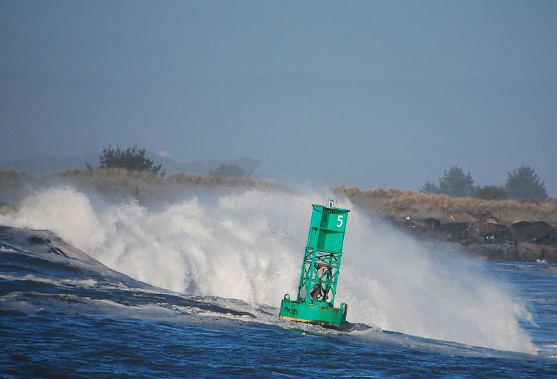 Buoy clanging around in the waves near the South Jetty, Humboldt Bay.