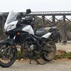 """The """"new"""" V-Strom near the Fort Brag trestle, which no longer serves trains.  Ocean behind the trestle."""