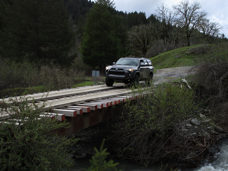 """Bridge made of an old railroad car, 6""""x6"""" lumber, and some boards... on County Line Creek Road"""