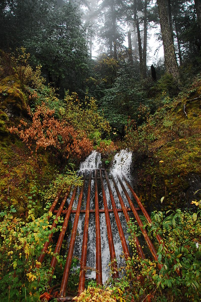 Waterfall with metal guard over it on Larabee Butte Road