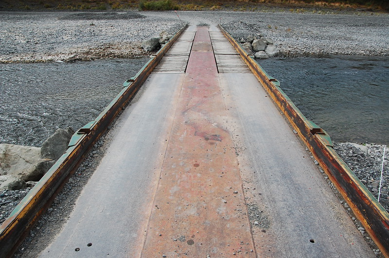 Humboldt County Road Dept installs this temporary bridge over the Eel River in the summer, they remove it in winter (rainy season) because it would be carried off by flooding.  It cuts 30 minutes off a trip to or from the small town of Shivley.