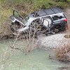 Someone failed a river crossing... and abandoned their (previously) nice Toyota Sequoia!