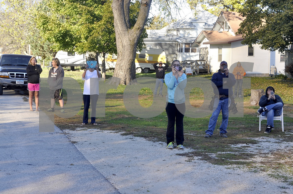 -Messenger photo by Chad Thompson<br /> <br /> Onlookers from around the neighborhood in Callender came equipped Ipads and cell phones to capture the destruction of the grain elevator, located on Rankin Avenue, Sunday morning. The elevator had been there for since the early 1900s.