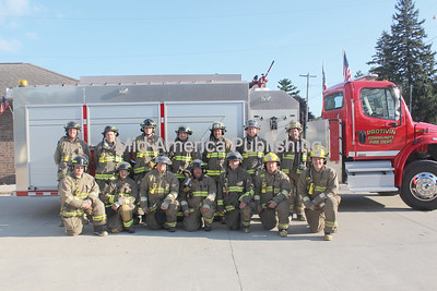 Protivin Fire Department Pictured are (front row, l-r): Martin Ahrndt, Jeff Meyer, Eric Shimek, Cory Ellingson, Darren Pecinovsky, Adam Powers and Kyle Reicks; back row: Brian Jestrab, Dan Vrba, Nate Gillen, Tim Beckman, Dean Dietzenbach-2nd Captain, Chris Shimek-2nd Lieutenant and Protivin Fire Chief Brady Moudry. Not pictured: A.J. Straw-1st Assistant Chief, Mike Panos-2nd Assistant Chief, Ken Humpal-1st Captain, Dean Hubk-1st Lieutenant, Jason Hrdlicka, Nate Mracek, Casey Sebastian and Greg Shimek.