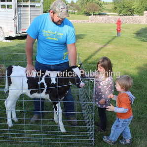 NICC Welcomes Guests Camille and Callen Rueckert inspect one of the visitors to the campus yard at Northeast Iowa Community College (NICC) during the annual event Thursday. The two were among guests who had fun with games and food. Photos by Michael Hohenbrink