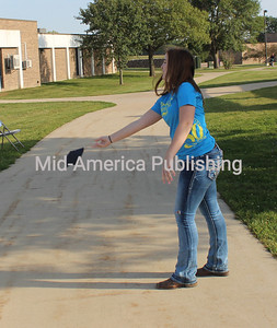 Kenzie Hovden tries her hand at tossing.