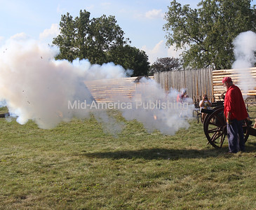 With smoke and a roar, a canon is fired.
