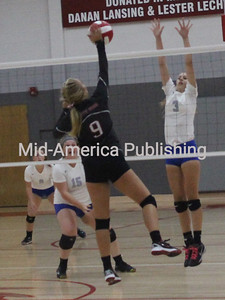 Alexis Bohr works to put the ball over the net as South Winneshiek hosted West Central. Photos by Michael Hohenbrink