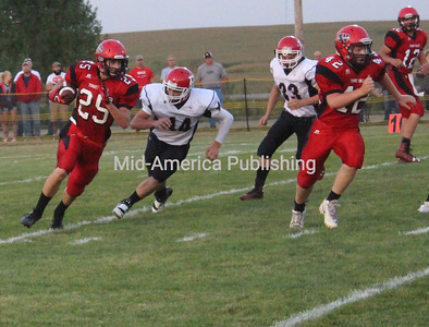 Will Einwalter works the ball down the field as he carries the ball toward the the first touchdown for Turkey Valley.