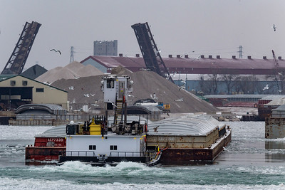 Tow boat moving four barges on the Calumet River south of 100th Street, 106th Street bascule bridge is open in the distance. 2/17/19