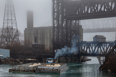 Calumet River towboat with open barges crossing under the Norfolk Southern railroad bridge. 3/28/20