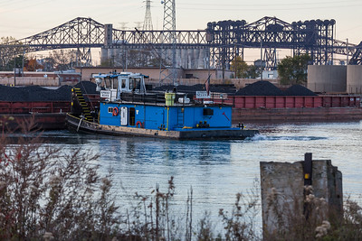 Open barges of coal or coke parked near the mouth of the Calumet River on the east bank. 11/2/18