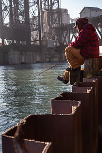 Fisherman on the Calumet River, on pilings under the Norfolk Souther railroad bridge. 1/5/19