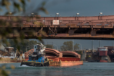 Barge and barge covers heading north under the 95th Street bridge on the Calumet River.
