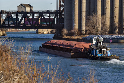 Tow boat pushing barge on the Calumet River, towards Norfolk Souther railroad bridge. 12/17/18
