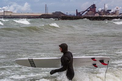IMG_3253.jpg Surfer in Lake Michigan at Whiting park and the ArcelorMittal steel mill in East Chicago, Indiana. 4/19/19