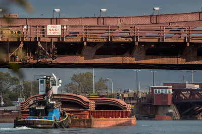 IMG_5981.jpg  Tow boat pushing barge stacked with barge covers, under the 95th Street bridge on the Calumet River. 10/24/18