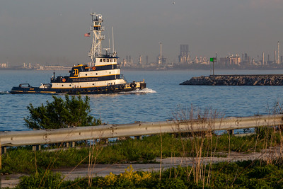 IMG_1345.jpg Tug boat heading into the mouth of the Calumet River from Lake Michigan, with the BP Refinery in Whiting Indiana visible across the water. 5/15/19