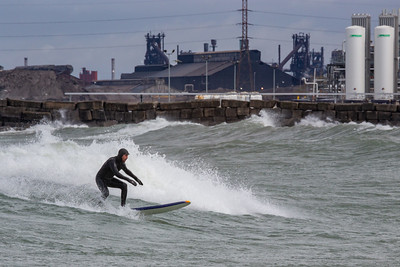 IMG_3335.jpg Surfer in Lake Michigan at Whiting park and the ArcelorMittal steel mill in East Chicago, Indiana. 4/19/19