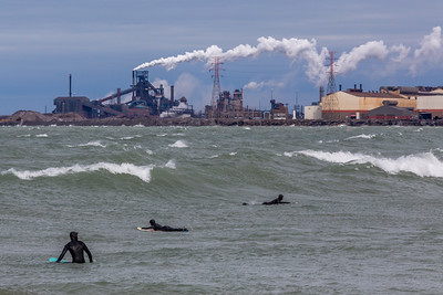 IMG_3455.jpg  Surfers in Lake Michigan at Whiting Park and the ArcelorMittal steel mill in East Chicago, Indiana. 4/19/19