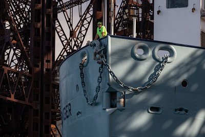 IMG_1743.jpg  Crewman keeping watch as the cement carrying vessel, St Marys Challenger, heads under the Norfolk Southern railroad bridge and up the Calumet River towards Lake Michigan. 8/11/20